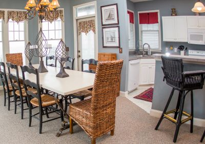 Kitchen and dining area at Pink Pelican cottage - Manteo, NC